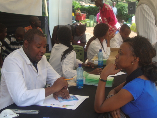 Dental volunteers consulting with patients