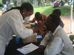 Dental care volunteers examining patients