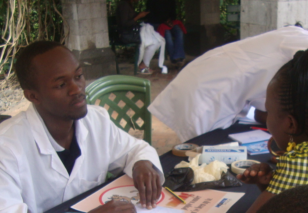 David Mundia taking a history of patient