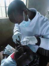 Dr. Mundia examining patient