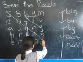 Students use a word puzzle to learn English