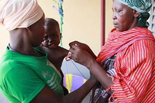 Massaguet: volunteer screens baby for malnutrition