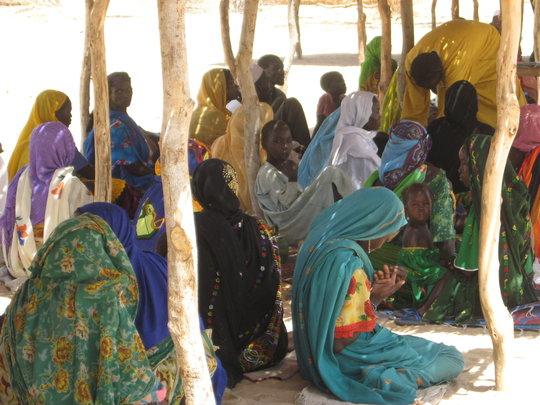 Women waiting at an outreach health post.