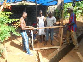 Building of latrine cover frame