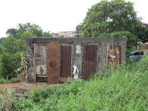 Outside of crumbling latrines at clinic site