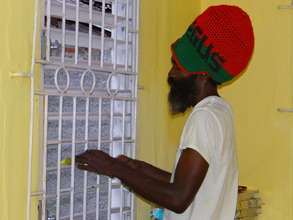 Reggae Singer, I Righteous helps to clean window
