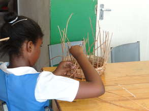Student Making a Basket in Arts and Crafts Section