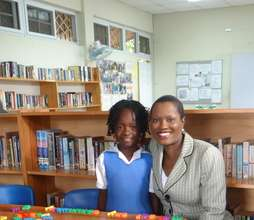 CEF President with a Student in the Center Library