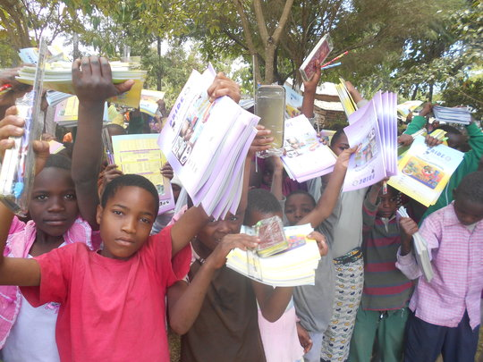 Children receiving school books