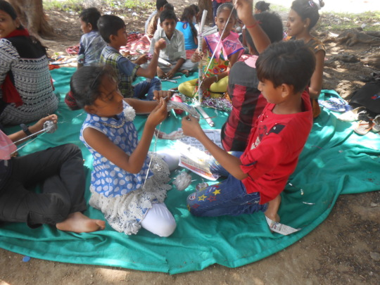 Children working together during the outdoor camp