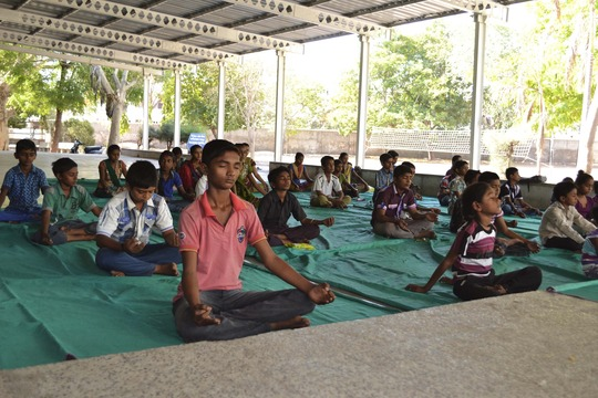 Relaxing with yoga at vacation camp